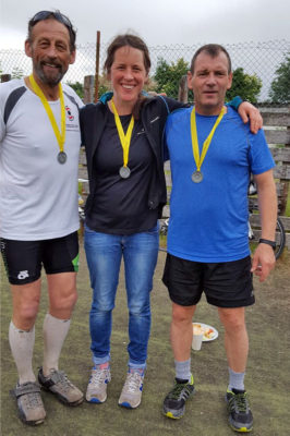 George (left) and his team proudly sporting their finishers medals